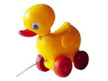 nostalgisch speelgoed trekeendje geel